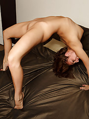Fun Loving Teen Jumps Around on Bed Showing Cervix
