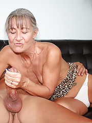 Horny granny jerking off a monster cock
