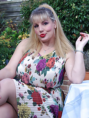Danielle T takes off her flowery dress to flash those huge boobs outside