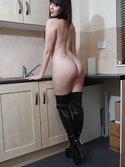 Naughty young housewife Sammi Jo is naked in the kitchen apart from a pair of sexy