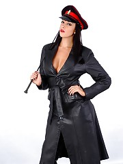 Hot busty Femdom Sammi Jo is in charge wearing only a long black leather trench coat