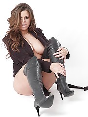 Busty Leanne shows off her biggest assets in a pair of black knee high leather boots