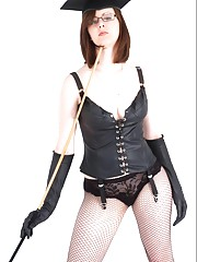 Sophisticated brunette Mistress shows off her great body in leather corset gloves
