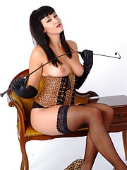 Busty femdom Sammi Jo has her tits out with her gloves on holding her cane