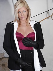 Sexy blonde femdom Victoria holding her cane in sexy leather gloves