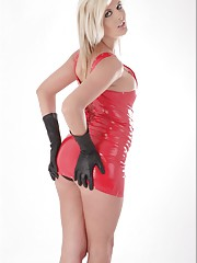 Victoria Summers in a tiny red latex dress and black leather gloves