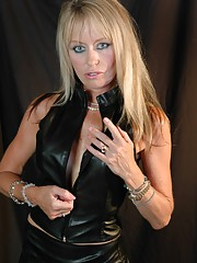 Kinky femdom Milf Alex is armed and extremely dangerous in her tight leather outfit