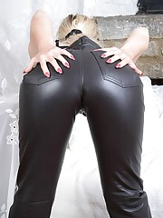 Horny blonde Milf Nicole slowly removes her tight leather pants then uses them to