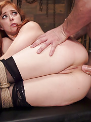 Anal sex slave Penny Pax shows off her shaved submissive pussy and asshole before