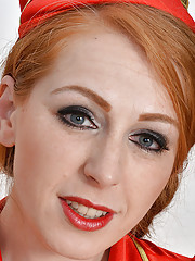 Gorgeous redhead stewardess Tia Jones gets home and flashes her hairy hole