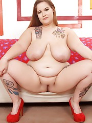 Fat tattooed girl takes off her clothes and spreads her pussy and ass