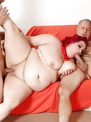 Redheaded plumper Eliza Allure takes one big cock in her pussy and another in her