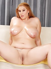 Full-figured Angel Deluca oils up her big tits and poses her sexy body
