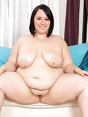 Cute BBW Alexxxis Allure strips off her pink dress and shows pussy