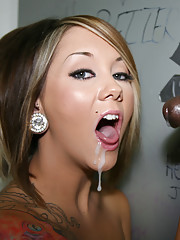 Teen punk sucks off black dick at a gloryhole