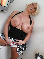 Busty MILF plays with anonymous black cock