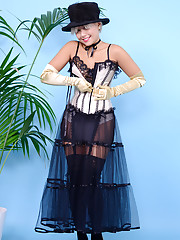 Glamorous Petra Lily So in satin corset gloves and knee-socks knows how to tease.