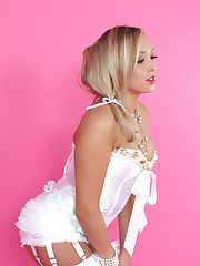 Sexy blonde strips from corset and white stockings.
