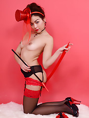 Cute brunette in latex corset and stockings shows us her wicked side.