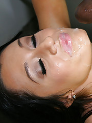 Black haired beauty sucking black cock