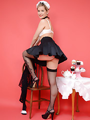Cute blonde waitress shows off her black seamed stockings.