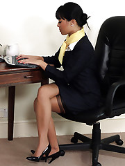 Two naughty office girls fall out in the office and decide to teach each other a
