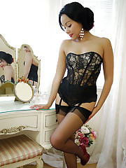 Dazzling brunette Petra So strips to nude from a sexy evening dress and lingerie.