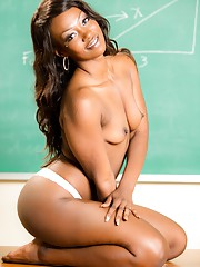 Attractive ebony playgirls spreads her wet black pussy in a classroom