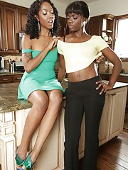 Two stunning ebony babes Lotus and Ana spread their black pussies