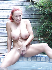 Big breasted British MILF playing in th hottub