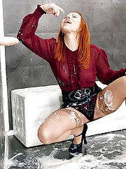 Redhead gets showered with hot sperm on gloryhole
