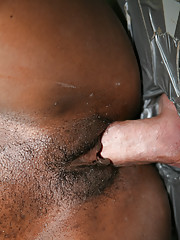 Slutty ebony playgirl Eunique slides a fat cock in her black pussy