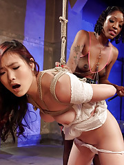 Naughty ebony babe has her black pussy pleasured by an Asian chick