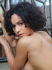 Busty Pammie Lee flaunts her curvy body with round ass as she poses sensually on