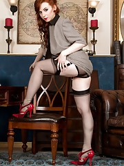 Vivi the cute redhead temp gets into some sex play stripping out of her skirt suit