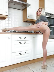 Nothing is cookin except Michelle in her super sheer nude hose and stiletto pumps!