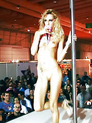 Petite blonde stripper seducing a guy on stage