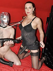 Strapon Jane thrusts her huge collection of strapons deep inside her gimps mouth