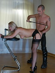 Kinky office slut enjoys a good hard spank