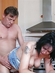 Mature couple loves to fuck in their kitchen