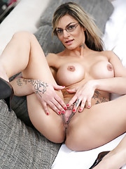 Tattooed slut in glasses stripping to show big tits & toy with vibrator
