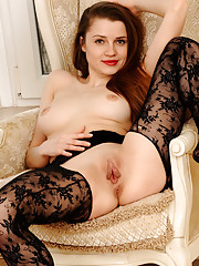 Wearing delicate silk lace lingerie and hosiery Pandora confidently poses and show