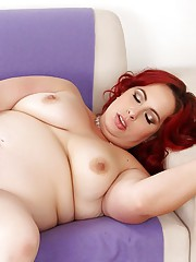 Redheaded chubby gives a blowjob before she takes the dick inside her fat twat