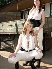 Lesbians Christy Marks and Terry Nova model in sexy riding apparel and boots