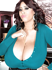 Naughty black BBW Roxi Red shows off her massive black boobs