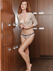The stunning Mia Sollis posing in a cropped top that showcase her tight torso and