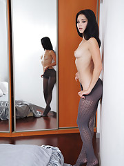 Malena poses in her gray stockings that highlight her beautiful firm ass and sexy
