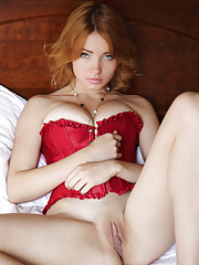 Kika39s bright red corset compliments her fair porcelain smooth skin highlighting