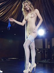 Sometimes a striptease needs a big stage and here Sam has one and a big pole all
