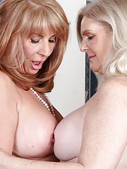 Older licking lesbians Judy Belkins and Rae Hart.